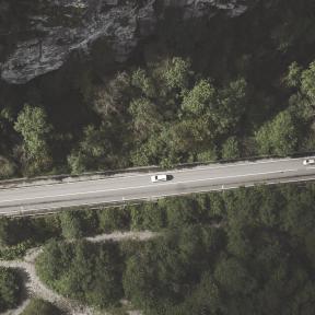 #Photo #FreePhoto #cars #highway #UNSPLASHIMAGE #shot #road #tree #hills. #surrounded #of